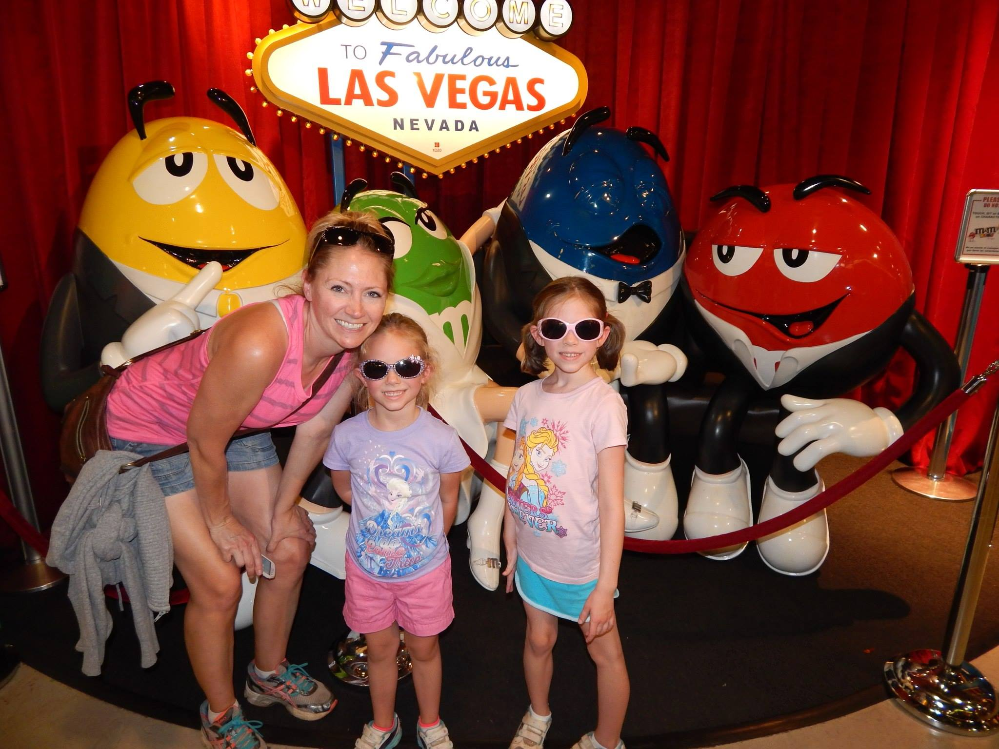 Julie and her daughters at M&M World